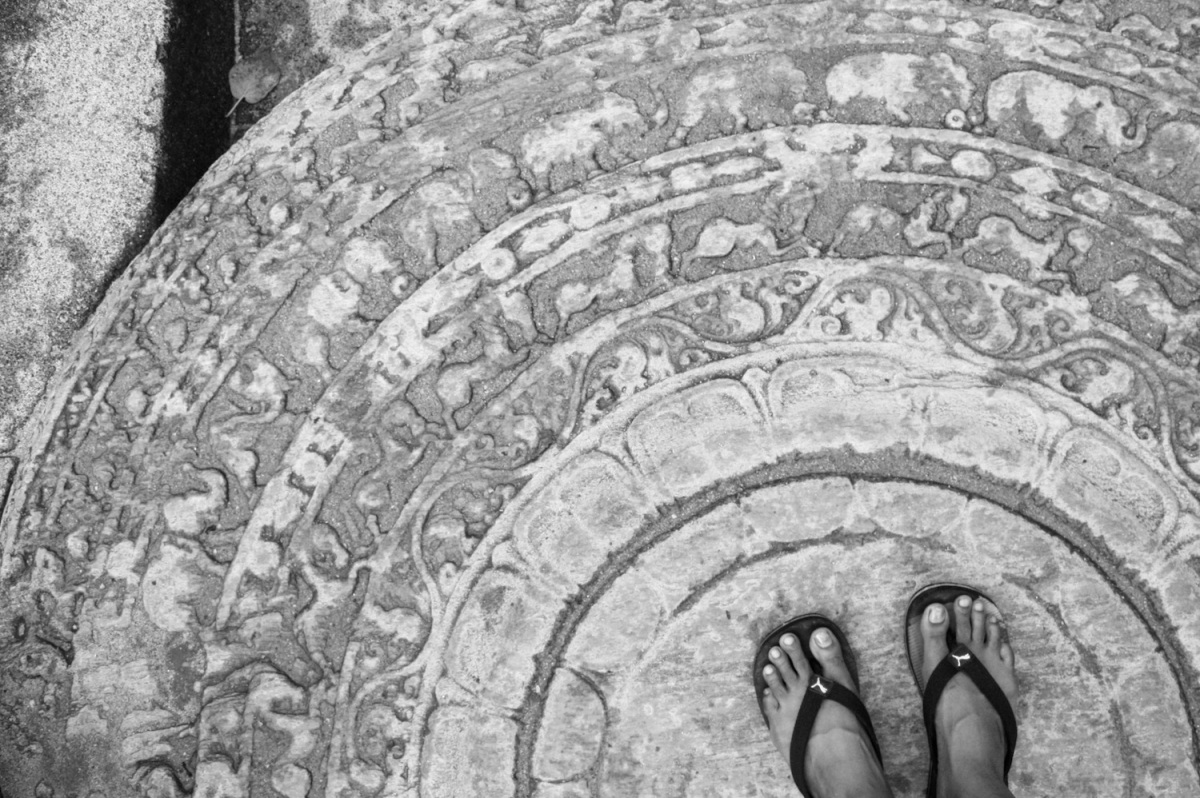 stepping on the sandakada pahana (moonstone) at srilanka