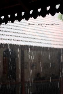 rain cascades down