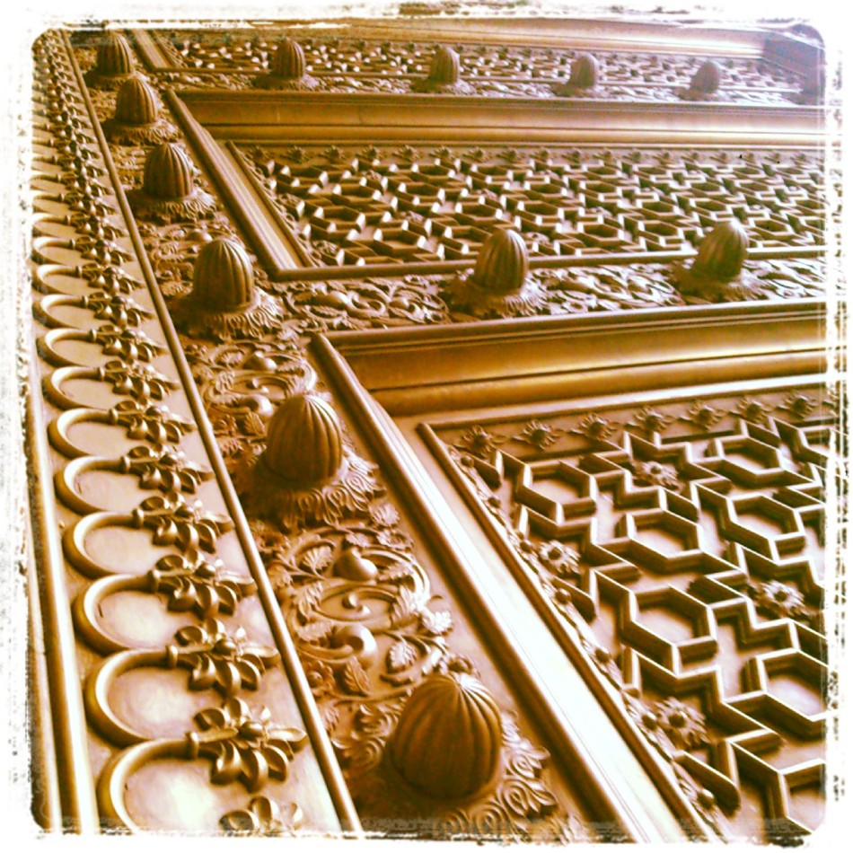 bronze carved door at city palace