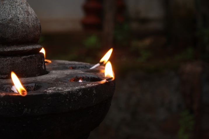 stone diya at a temple, kerala