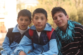 Three uber cool kids at Kaza. They were commenting about every passerby and laughing. So I asked them for a photograph :)