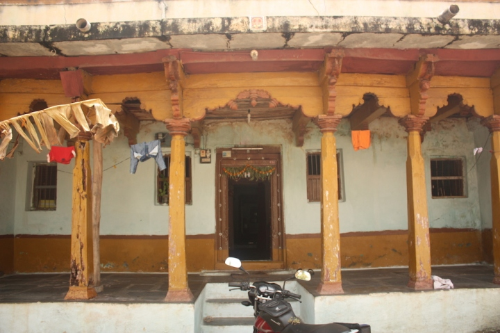 Houses in Anegudi, with the wooden painted pillars along the front verandah.