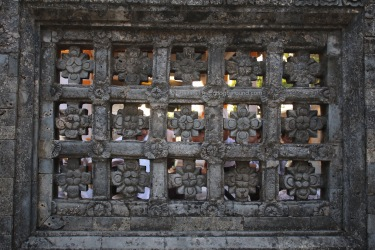 this pretty stone window reminds me of temples in india